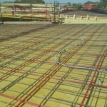 image of rebar conduit on a job site before PT slab is installed